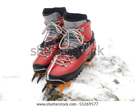 ice climbing boots with crampons - stock photo