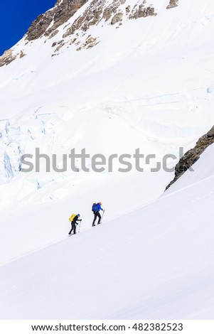 Ice Climbing on glacier in the mountains of Switzerland - Aletsch Glacier