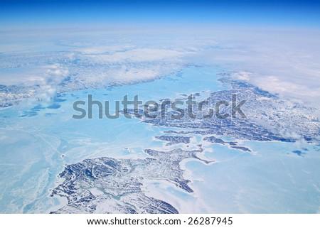 ice coast of greenland with blue shades - stock photo