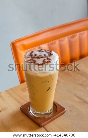 Ice coffee cappuccino with cute cat - stock photo