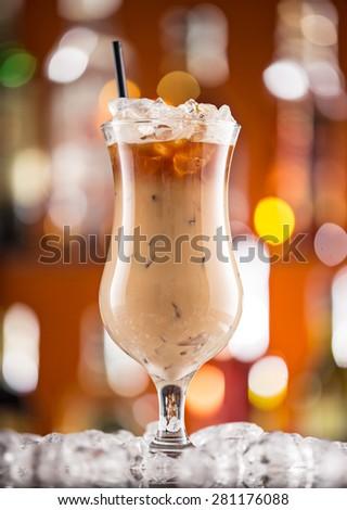 Ice coffee on bar desk, close-up. - stock photo