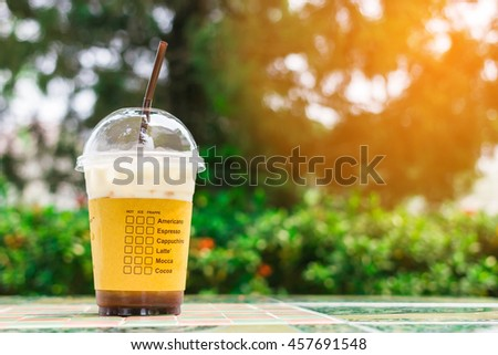 Ice coffee on the table in the morning  light.( Vintage tone ) - stock photo