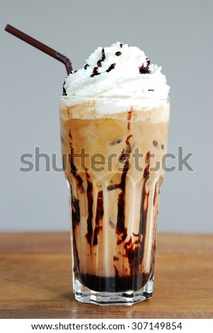 Ice coffee with cream on table - stock photo