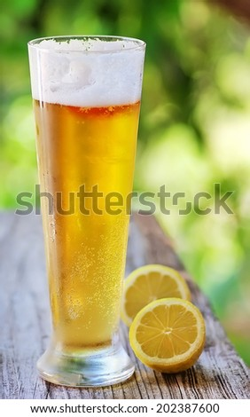 Ice cold beer and lemon - stock photo