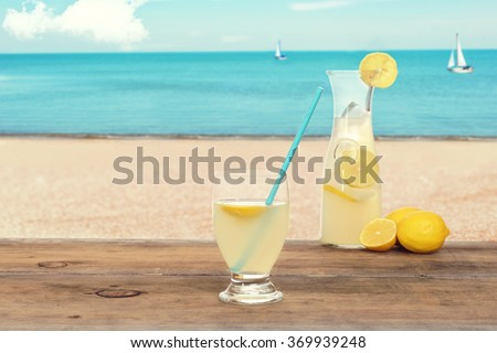 ice cold lemonade at the beach - stock photo