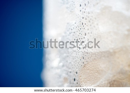 Ice Condensation Glass with Blue background Macro shot
