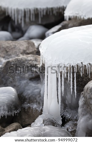 Ice covered rocks - stock photo