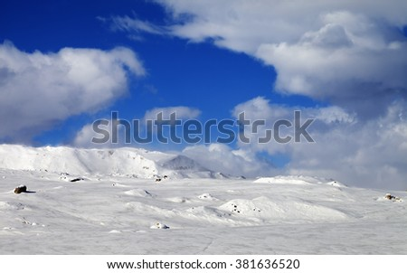 Ice-covered slope and snowy mountains in fog. Greater Caucasus, Shahdagh. Qusar rayon of Azerbaijan. - stock photo