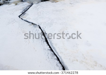 Ice crack nature close-up - stock photo