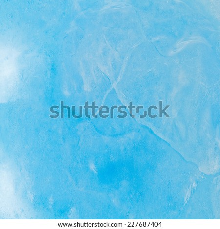Ice cracked surface of the lake in forest. - stock photo