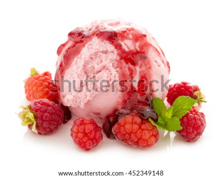 Ice cream and fresh red raspberries.