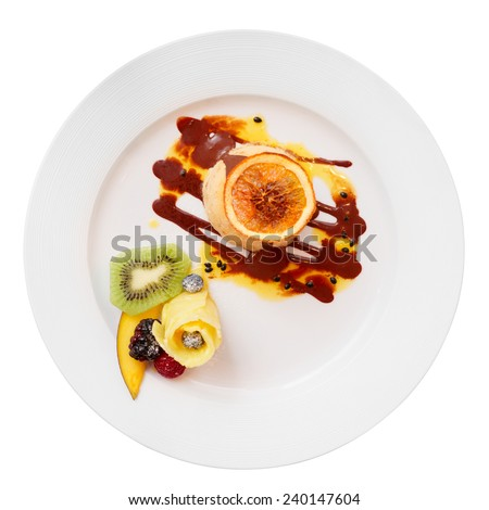 Ice-cream dessert with fruits in plate, isolated on white background - stock photo