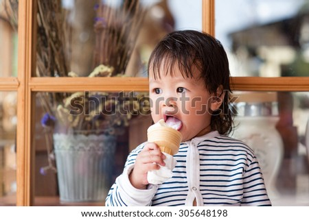 ice cream eating child little girl - stock photo
