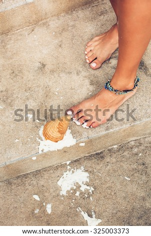 Ice cream fell on asphalt top view. Outdoors lifestyle