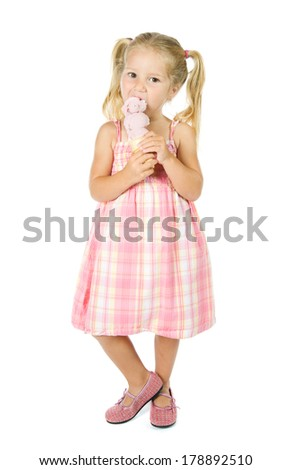 Ice Cream: Girl Standing And Eating Strawberry Ice Cream Cone - stock photo