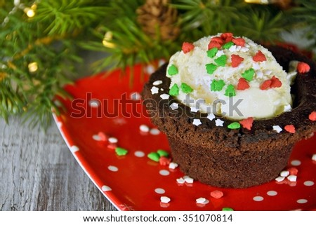 ice cream in brownie cup with Christmas sprinkles - stock photo