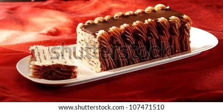 ice cream pie on plate with chocolate topping - stock photo