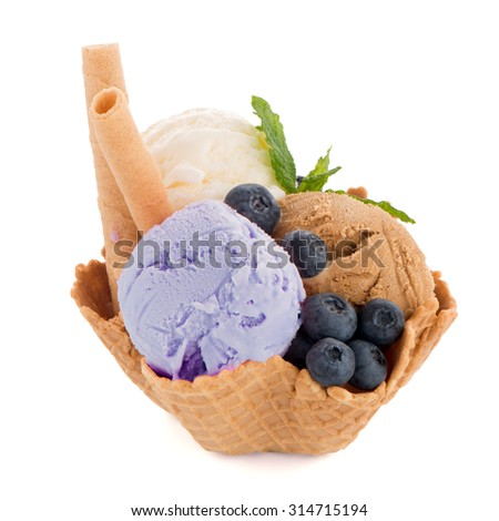 Ice cream scoops in wafer bowl on white background - stock photo