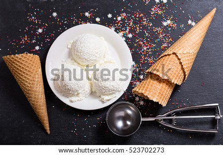 ice cream scoops on dark background, top view.
