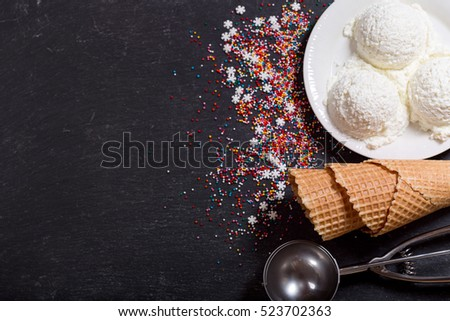 ice cream scoops on dark background, top view with copy space.