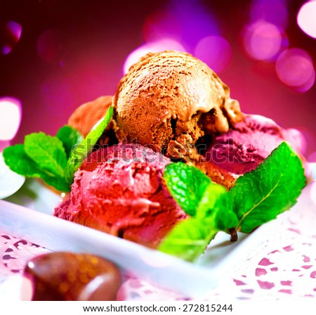 Ice cream scoops with various flavours- chocolate,fruits and berry. Brown, red and pink icecream served with dark chocolate topping and mint - stock photo