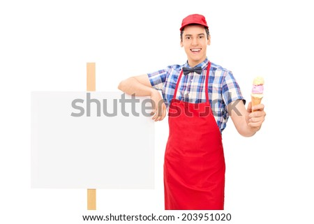 Ice cream seller standing by a blank signboard isolated on white background - stock photo