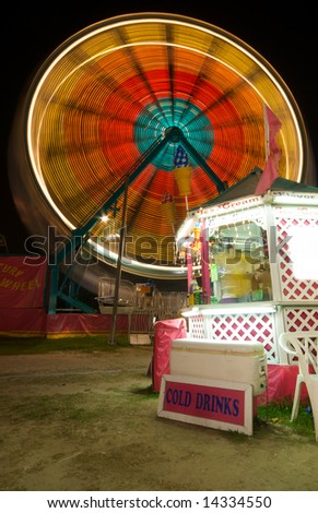 Ice Cream Stand at Carnival with Ferris Wheel