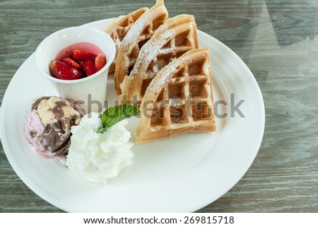 Ice Cream Waffles strawberry and Whipped cream on white dish For appetizers , desserts - stock photo