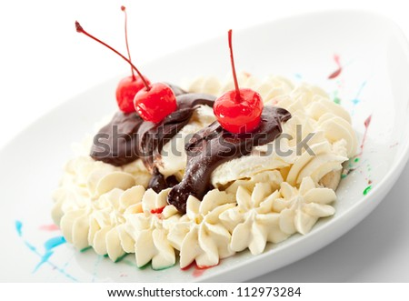 Ice Cream with Banana Served with Chocolate and Berries - stock photo