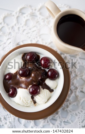 Ice cream with cherry and chocolate - stock photo