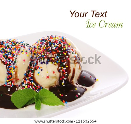 Ice cream with chocolate and candy sprinkles topping, isolated on white - stock photo