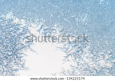 ice crystals on a window , close-up - stock photo