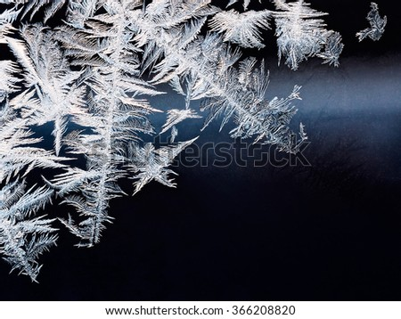 ice crystals on surface of frozen window as background - stock photo