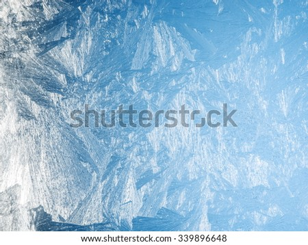 Ice crystals on the surface of the window. - stock photo