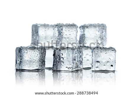 Ice cube and water drops on white background - stock photo