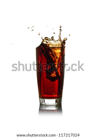 Ice cube droped in cola glass - stock photo