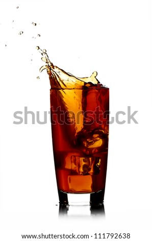 Ice cube droped in cola glass isolated