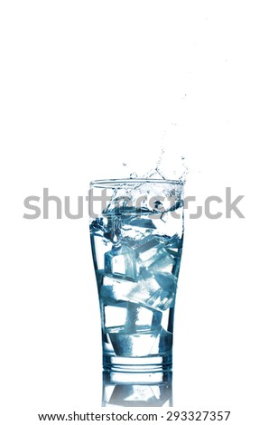 Ice cube dropped into a glass of water making splash isolated on white background