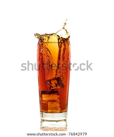 Ice cube in cola glass and cola splashing