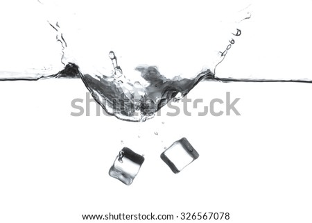 Ice cube is dropped into clear water isolated on white background