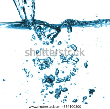 Ice cube is dropped into clear water isolated on white background - stock photo