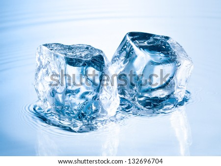 ice cube on water surface - stock photo