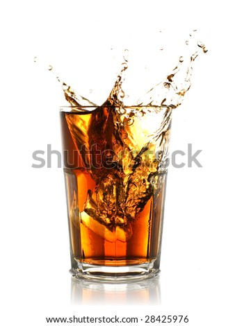 ice cube splashing into glass of coke