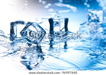 ice cube with pure water on reflective surface - stock photo