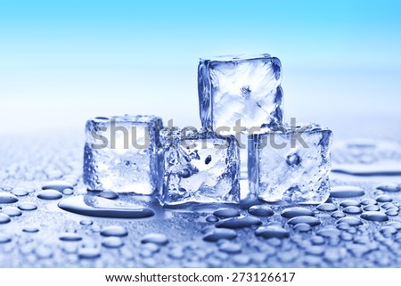 ice cubes and water drops on blue background
