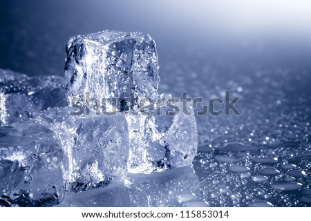 Ice cubes background abstract with copy-space and water drops in blue - stock photo