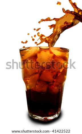 Ice cubes dropped in glass with cola