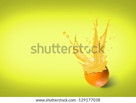 ice cubes fall into the orange, spray and splashes of juice - stock photo
