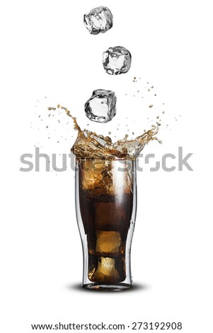 Ice Cubes Falling Into Glass of Cola Soft Drink With Splash - stock photo