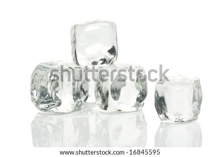 Ice cubes in a pool of water isolated on a white background - stock photo